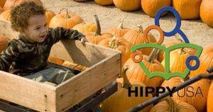 child in wagon at pumpkin farm